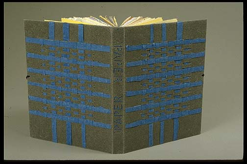 Donna and Peter Thomas. Paper: A collection of Papers from Hand Papermills in the United States of America. Covered in a limp Barrett UICB papercase paper; sewn longstitch; decor of woven Dieu Donné blue and Barrett paper; title as cutout on spine. 11 ¾  by 9 ¼  inches  Bound ca. 1995 GBW exhibit Paper Bound